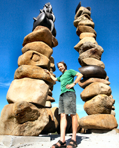 STONE TOWERS: Chris Booth between the sculpture's two tallest boulder columns.