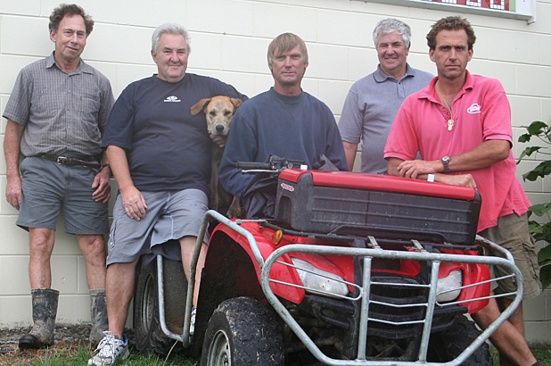 LANDCARE FARMERS: Some of the group involved with ridding the Okahukura Peninsula of pests, from left, John Lane, Bryan Bingley, Savanna, trapper Kerry Johnson, Wally McConnell, and Andre Hekkers.
