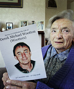 STILL GRIEVING: Cath Wootton keeps photographs of her son lined up on her mantle piece at home.