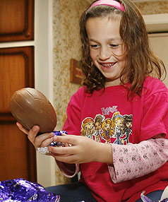 EASTER TREATS: Paige Ahlbrandt, 6, is thrilled with a chocolate Easter egg containing Moro bars.