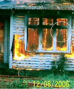 One of two photos taken during a Westport Volunteer Fire Brigade exercise in 2006. They appear to show ghostly heads in the burning house.