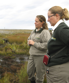 THREATENED:  Department of Conservation Awarua-Waituna Wetlands project manager Sally Chesterfield, left, and Awarua-Waituna community relations ranger Polly Bulling checking out the Seaward Moss wetland (part of the Awarua-Waituna Wetland), which fire destroyed three years ago.