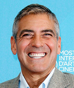NEW LOVE: George Clooney is set to move in with his new cocktail-waitress girlfriend.