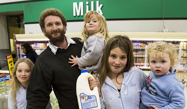 CHEAP AND HEALTHY: Martyn Grey, and his family, Chantelle, left, 10, Zavier, 3, Danyelle, 12 and Cameron, 18 months, drink Al and Sons milk because it costs less.