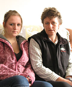 HOME SWEET HOME: Jocelyn Giles with daughter Georgia Giles-Petrie who feels too intimidated to return to school after being bullied by text message.
