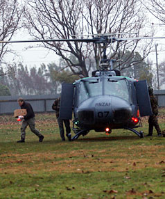 HUNTERS: Search team support gear is loaded aboard an RNZAF Iroquois helicopter at Levin showgrounds this morning.