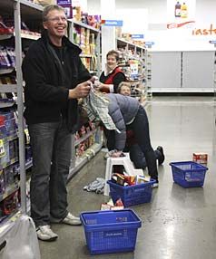 WHAT A MESS: Te Anau Fresh Choice owner Keith Cullen cleans up after the big quake.