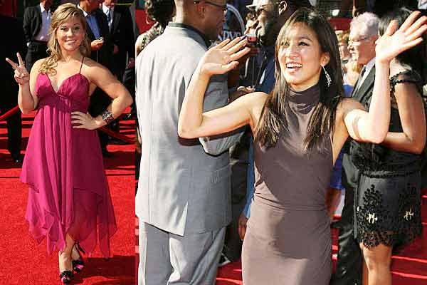 US gymnast Shawn Johnson (left) and figure skater Michelle Kwan wave from the red carpet after arriving for the taping of the 2009 ESPY Awards in Los Angeles.