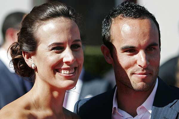 US football star Landon Donovan and his wife Bianca Kajlich arrive on the red carpet for the taping of the 2009 ESPY Awards in Los Angeles.