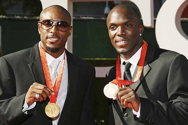 US track and field Olympians Angelo Taylor (left) and Lashawn Merritt show off their Beijing medals on the red carpet before the taping of the 2009 ESPY Awards in Los Angeles.