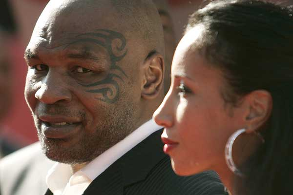 Former world heavyeweight boxing champion Mike Tyson arrives with his wife, Lakiha Spicer, for the taping of the 2009 ESPY Awards in Los Angeles.