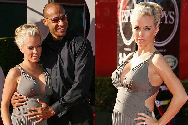 NFL Philadelphia Eagles wide receiver Hank Baskett, husband of Kendra Wilkinson, the former girlfriend of Playboy bunny founder Hugh Hefner, puts his hand on her pregnant tummy as they pose on red carpet before taping of 2009 ESPY Awards in Los Angeles.