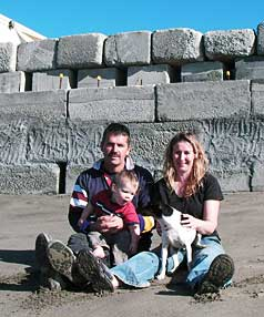 NEAT AND TIDY: Mark Lawrence, with partner Tracy Oliver  and   son Jackson, says his rebuilt seawall  will stay.