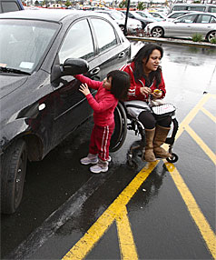 CLAMPED: Being paralysed from the chest down counted for little when Danielle Adams, with her niece Ada, was caught parking in a disabled car park at The Base.