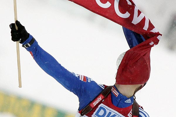 Russia's Ekaterina Iourieva gets wrapped up in a flag as she crosses the finish line after winning the Biathlon World Cup 4 x6 km relay competition in Hochfilzen.