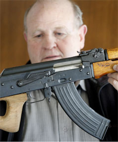 ILLEGAL WEAPON:  New Plymouth police arms officer Vaughan Watson with a rifle that would now be considered a  military-style semi-automatic under a new interpretation introduced this week.