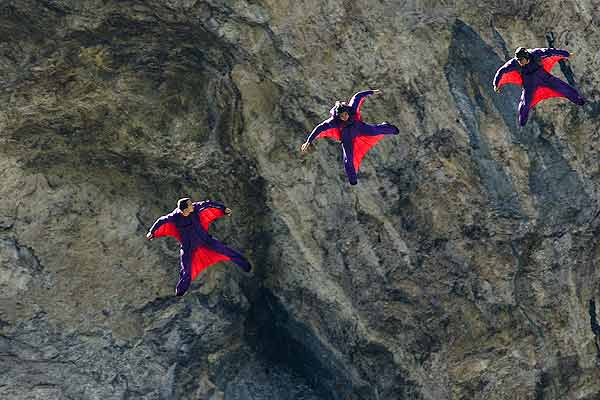 Base jumpers soar through the air in the Lauterbrunnen valley in the Bernese Oberland, Switzerland.