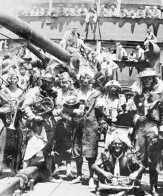 The crew of the Wolf  in fancy dress  as they cross the equator. The  German freighter was fitted  with   torpedos, guns and mines.
