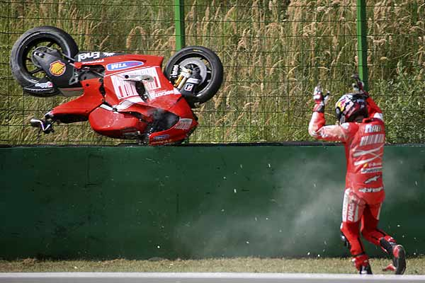 Ducati's Mika Kallio of Finland reacts after crashing during the classification session for the Czech Grand Prix at the Masaryk Circuit in Brno.
