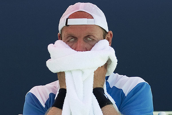 Germany's Rainer Schuettler towels off between sets as he plays France's Jo-Wilfried Tsonga during Rogers Cup tennis tournament in Montreal.