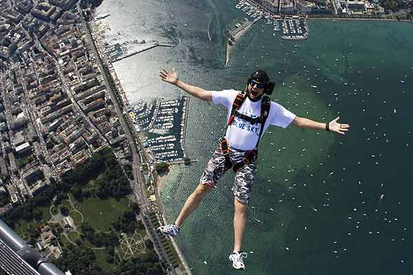 Christoffe Jonin of the FF Blue Sky Team jumps out of a helicopter with a parachute, 1300 meters above Lake Leman (Lake Geneva) and the city of Geneva.