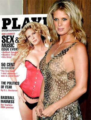 Model Rachel Hunter poses with an enlarged Playboy magazine cover featuring her photograph at a launch party in New York in 2004.