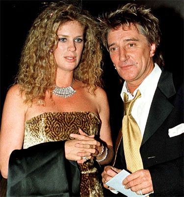 Rachel Hunter and then-husband Rod Stewart pose as they arrive at a charity ball in 1998.