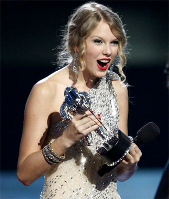 Taylor Swift accepts the award for best female video for You Belong with Me before Kanye West storms the stage at the 2009 MTV Video Music Awards.