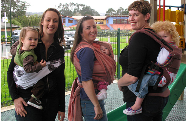 SLING LOW: From left: Julie Wright-Winslow, with 17-month-old Charlie Winslow, Jessica Richards, carrying four-month-old Lorelai and Rochelle Jansen and her two-year-old Ava.