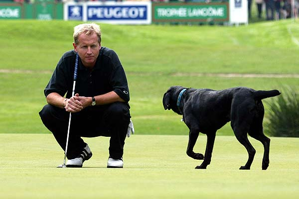 Philip Golding of England is approached by a stray dog as he studies a putt on the 7th green during the second round of the Lancome Trophy at Saint Nom La Breteche.