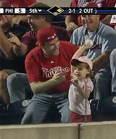 Little Emily Monforto about to throw her dad's foul ball catch back during a MLB game in Philadelphia.