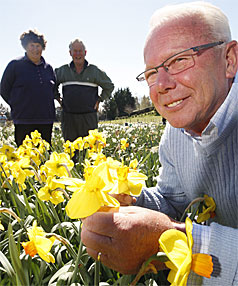 GLOBAL FLOWERS: Marie and John Hunter, back, are hosting visiting bulb grower Jan Pennings from the Netherlands.