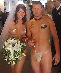 MAN AND WIFE: Shane and Cherie pictured in their wedding `outfits' this morning.