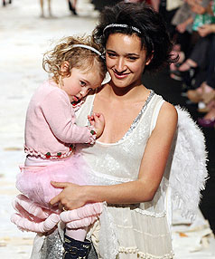 HELPING HAND: Keisha Castle-Hughes takes to the runway with her daughter Felicity-Amore during the Trelise Cooper Kids show at Air New Zealand Fashion Week.