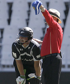 Jesse Ryder is injured during New Zealand's Champions Trophy win over Sri Lanka.