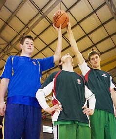 THE AIR UP THERE: St John's College centre Mark Overdevest (2.18m) and Westlake Boys' High School centre Rob Loe (2.11m) tower over 1.78m tall Westlake guard Mitch Richmond.