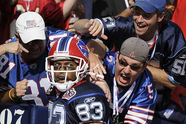 Buffalo Bills wide receiver Lee Evans celebrates with fans after scoring a touchdown against Tampa Bay Buccaneers during NFL football action in Orchard Park, New York.