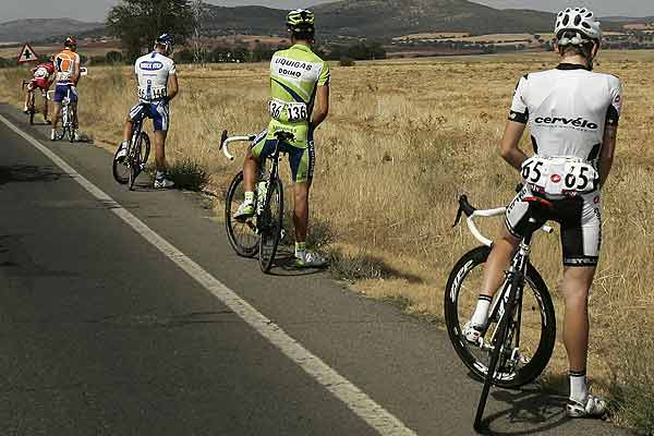 Riders urinate during the 17th stage of the Tour of Spain