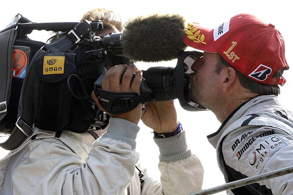 Brawn GP Formula One driver Rubens Barrichello of Brazil kisses the TV camera on podium after winning the Italian F1 Grand Prix in Monza.