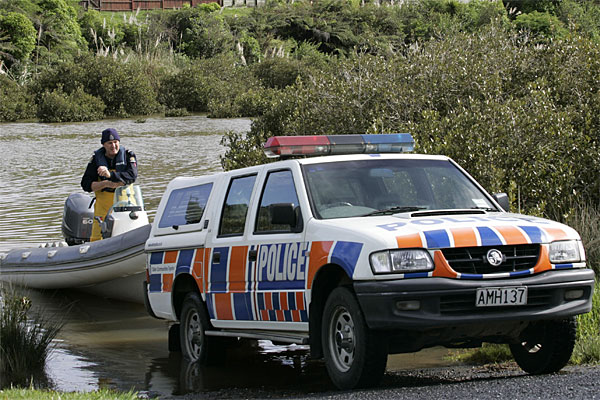 AREA COMBED: Police search one of the waterways near the street where toddler Aisling Symes went missing.