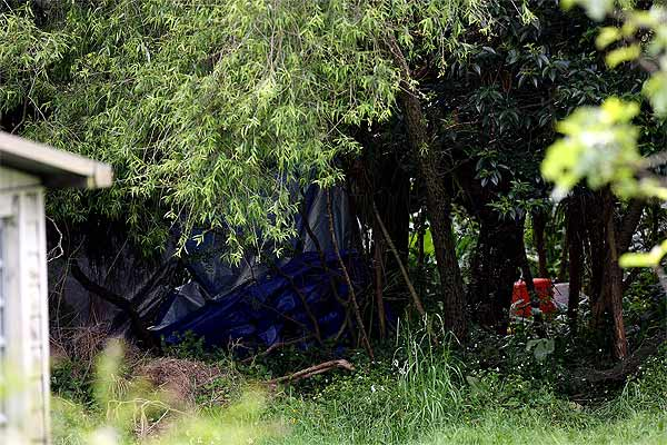 SAD FIND: Scene of where searchers were digging behind a west Auckland property overnight near the location where Aisling Symes went missing a week ago.