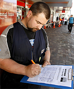 SIGN HERE:  Tony Phyn of Richmond signs the Save the Makos petition in Trafalgar St.