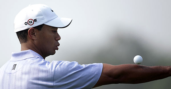 Tiger Woods of the US balances a ball as he plays on the 8th hole during the 2009 HSBC Champions golf tournament in Shanghai.