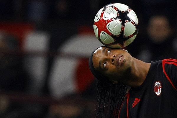 AC Milan's Ronaldinho controls the ball during a warm-up session before their Champions League football match against Real Madrid at the San Siro stadium in Milan.