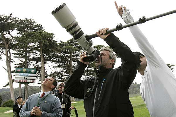 International team assistant team captain Frank Nobilo of New Zealand looks through a camera to identify the ball of Angel Cabrera of Argentina that is stuck in a tree during his fourball match at the Presidents Cup golf tournament at Harding Park Golf Course in San Francisco.