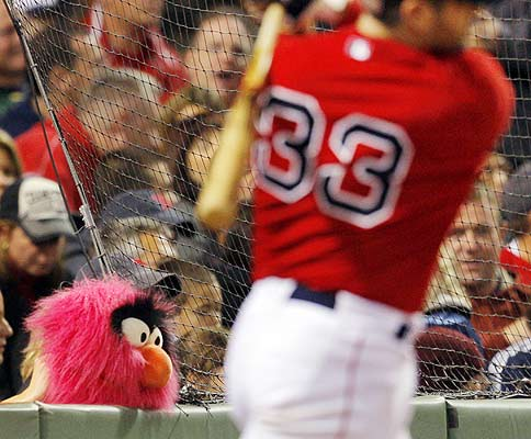 A fan holds up a puppet while the Boston Red Sox's Jason Varitek warms up on deck in the sixth inning of their MLB American League baseball game against the Cleveland Indians at Fenway Park in Boston.