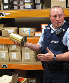 BIG WHACK: Constable Paul Mark with one of the blank howitzer shells that turned up at Blacks Fasteners yesterday.