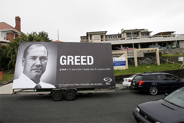 TURN UP THE HEAT: A Hell Pizza mobile billboard depicting Mark Hotchin and their Greed pizza outside Hotchin's multi-million dollar house under construction in Auckland's Paratai Drive.