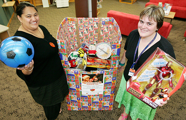 GENEROUS READERS: Manurewa library assistant Maori services Margaret Ngapopo, left, and Manurewa library assistant youth services Phillippa McKenzie hold up the toys people have donated to the Salvation Army and Manukau Courier Christmas Appeal.