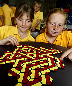 CREATING A MONSTER: Ranzau School pupils Alaina Burr, left, and Olivia Wells, both 10, with their  creature that they created by playing the new game Palago.
